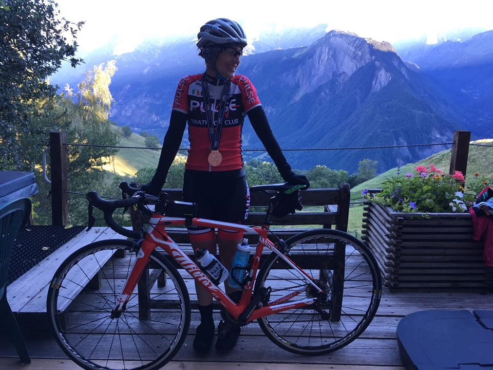 Bea posing with her bike and mountains in the background - Bea Gol: Alpe d'Huez, France, posted 3 July 2017.
