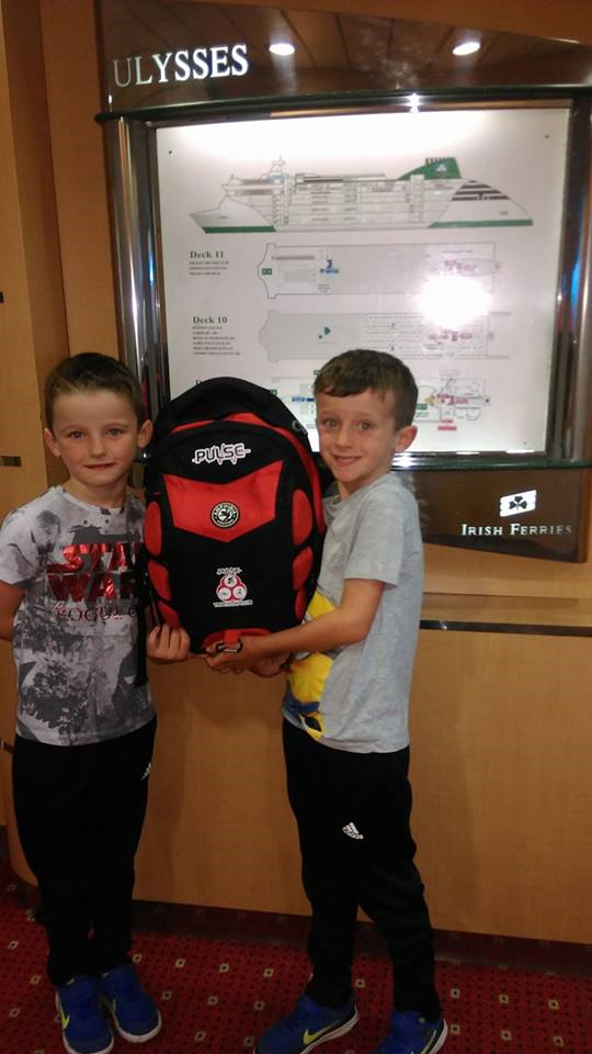 Brian's two sons holding up a Pulse bag on the Ulysses car ferry - Brian McAuley, posted 14 July 2017