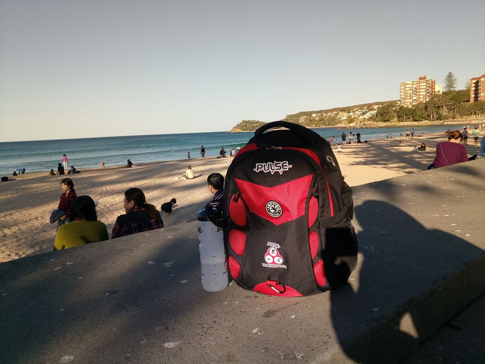 Pulse bag and bottle resting on a wall overlooking Manly beach - Carlos Nunos: Manly Beach, Sydney, posted 17 August 2017.