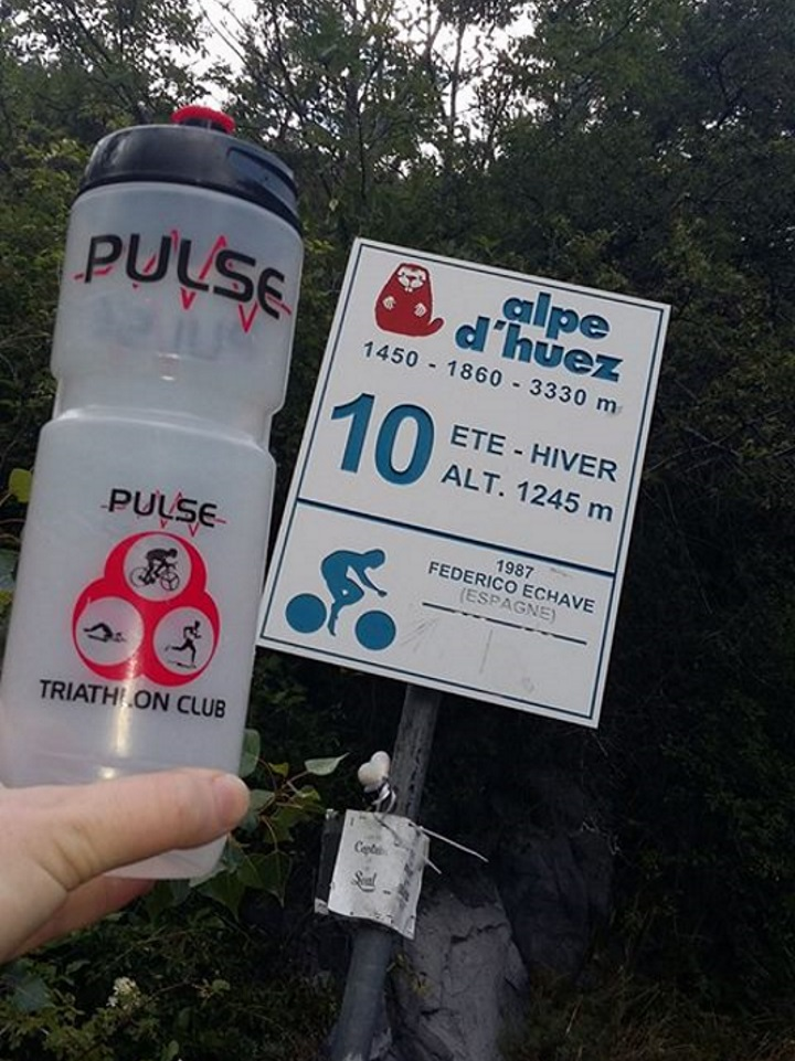 Pulse water bottle beside the sign for Corner 10 (Irish Corner) on the Alpe d'Heuz - Siobhán Quain: Corner 10, Alpe d'Heuz, posted 26th July 2017.