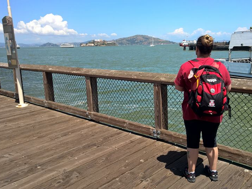 Wendy standing on wharf and looking outwards across the bay towards Alcatraz Island - Wendy Michelle Durkan: Fisherman's Wharf, San Francisco, posted 14 May 2017.
