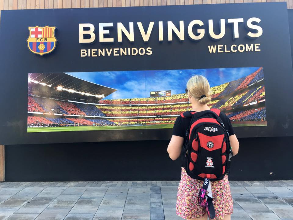 Jen standing with Pulse bag outside Camp Nou Stadium - Jen Shorten, Barcelona, posted 6th October 2017.